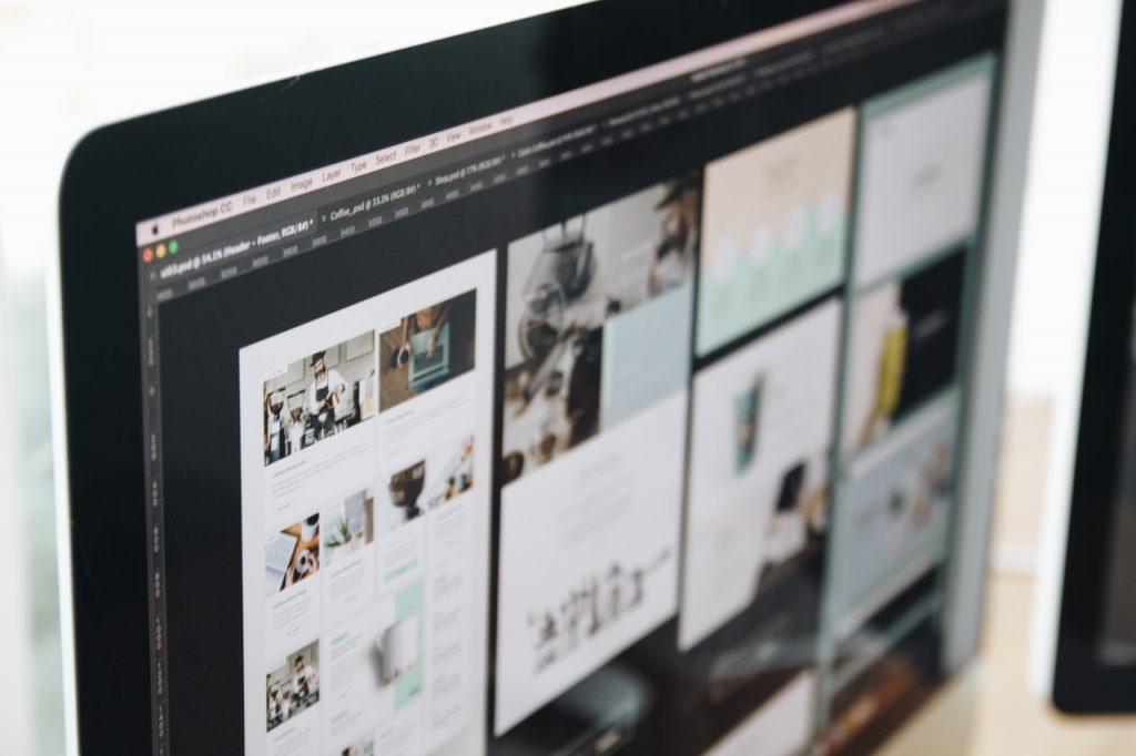 Web design mockups on a large screen